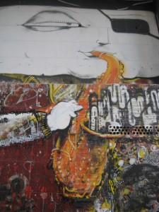 Street art of saxaphonist, up close